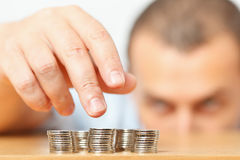 Businessman hand reaching for pennies Royalty Free Stock Photo