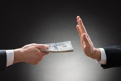 Businessman hand rejecting an offer of money Royalty Free Stock Image