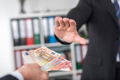 Businessman hand rejecting an offer of money Stock Images