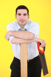 Businessman  with hand-saw. Businessman stood with hand-saw Royalty Free Stock Image