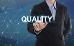 Businessman hand select wording quality. Sign on virtual screen. business concept Stock Photo