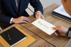 Businessman hand sending a resignation letter to executive boss dismissed worker quit out from company, Change job, unemployment, royalty free stock images