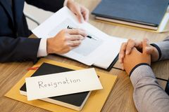 Businessman hand sending a resignation letter to executive boss dismissed worker quit out from company, Change job, unemployment,. Resign concept stock images