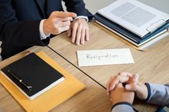 Businessman hand sending a resignation letter to executive boss dismissed worker quit out from company, Change job, unemployment,. Resign concept royalty free stock photos