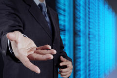 Businessman hand and server room Stock Images