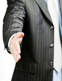 Businessman hand shake. A business man reaching his hand out to shake Stock Image