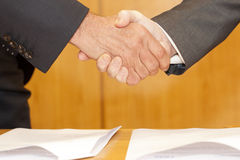 Businessman hand shake. After an agreement has been signed Stock Photo
