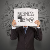 Businessman hand show book of BUSINESS NEWS Stock Image