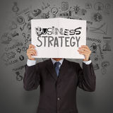 Businessman hand show book of business strategy Stock Images
