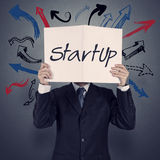 Businessman hand show book of startup business Stock Images