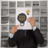 Businessman hand show book of thinking outside the box Royalty Free Stock Photography