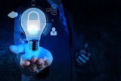 Businessman hand show 3d light bulb  icon. With padlock as Internet security online business concept Stock Photography