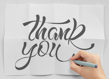 Businessman hand show design word THANK YOU. Businessman hand drawing design word THANK YOU on crumpled paper as concept Royalty Free Stock Images