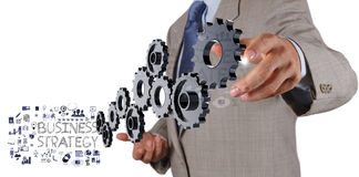 Businessman hand show gear cogs Stock Images