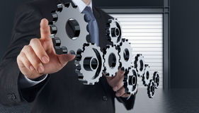 Businessman Hand Show Gear To Success Stock Photo