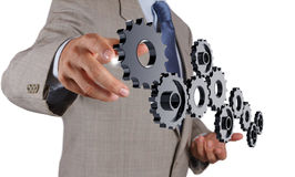 Businessman hand show gear to success Royalty Free Stock Image
