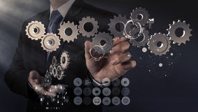 Businessman hand show gear to success Royalty Free Stock Images