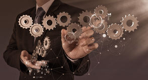 Businessman hand show gear to success Stock Photography