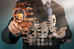 Businessman hand show gear to success Stock Image