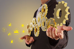 Businessman hand show golden gear to success as industry concept Stock Photography