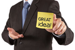 Businessman hand show great idea words on sticky note with white Royalty Free Stock Images