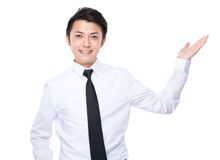 Businessman with hand show with something Royalty Free Stock Images