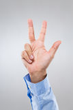 Businessman hand show with three finger Royalty Free Stock Photography