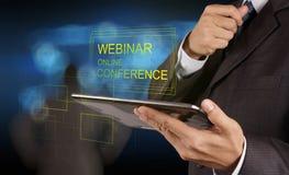 Businessman hand show webinar online conference stock image