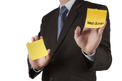 Businessman hand show well done words on sticky note with white Stock Images