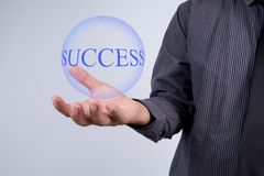 Businessman hand showing blue ball with success word. Marketing Royalty Free Stock Photography
