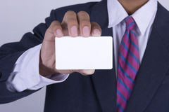 Businessman hand showing business card Royalty Free Stock Photography