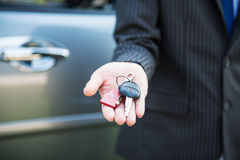 Businessman hand showing car key Royalty Free Stock Photo