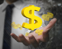 Businessman hand showing 3D golden dollar signs. Business man hand showing 3D golden dollar signs Stock Image