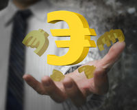 Businessman hand showing 3D golden euro signs Royalty Free Stock Photo
