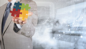 businessman Hand showing 3d puzzle as concept Stock Photography
