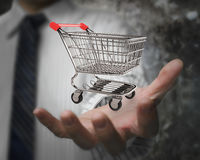 Businessman hand showing empty shopping cart Royalty Free Stock Image