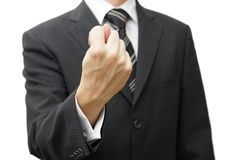 Businessman hand showing a fig sign. A businessman hand showing a fig sign Stock Image