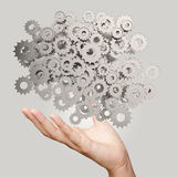 Businessman hand showing  gears cogs. To success concept Royalty Free Stock Image