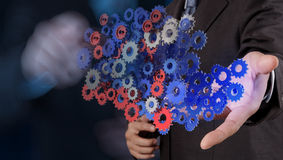 Businessman hand showing gears cogs Stock Photography