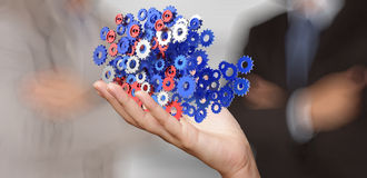 Businessman hand showing gears cogs to success Stock Photos
