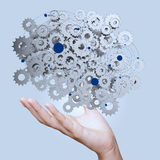 Businessman hand showing gears cogs to success Royalty Free Stock Images