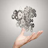 Businessman hand showing gears cogs to success Royalty Free Stock Photography