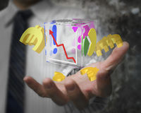 Businessman hand showing glass transparent cube euro symbols Royalty Free Stock Photos