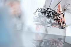 Businessman hand showing a house on touch screen Royalty Free Stock Photo