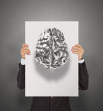 Businessman hand showing poster of 3d metal human brain Stock Photo