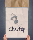 Businessman hand showing poster of start up icon Stock Images