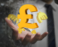 Businessman hand showing pound sterling symbol with euro signs Royalty Free Stock Photo