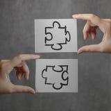 Businessman hand showing  puzzle partnership sign Stock Photos