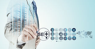 Businessman hand showing search engine optimization Stock Image