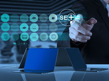 Businessman hand showing search engine optimization SEO Royalty Free Stock Photo